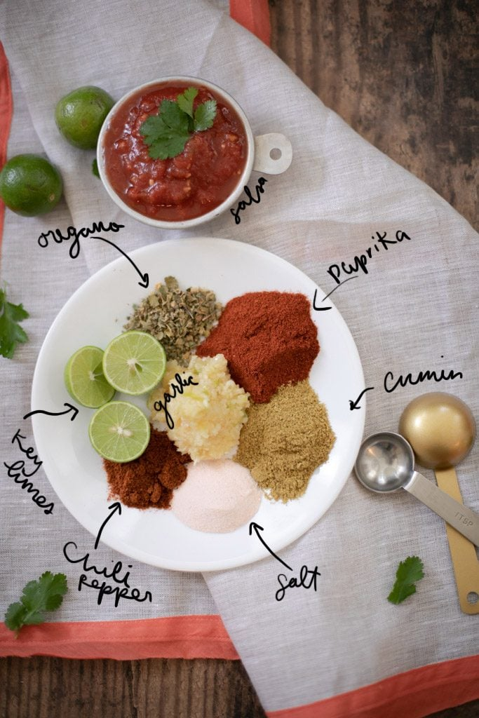 Plate with spices used for making Instant Pot carnitas.