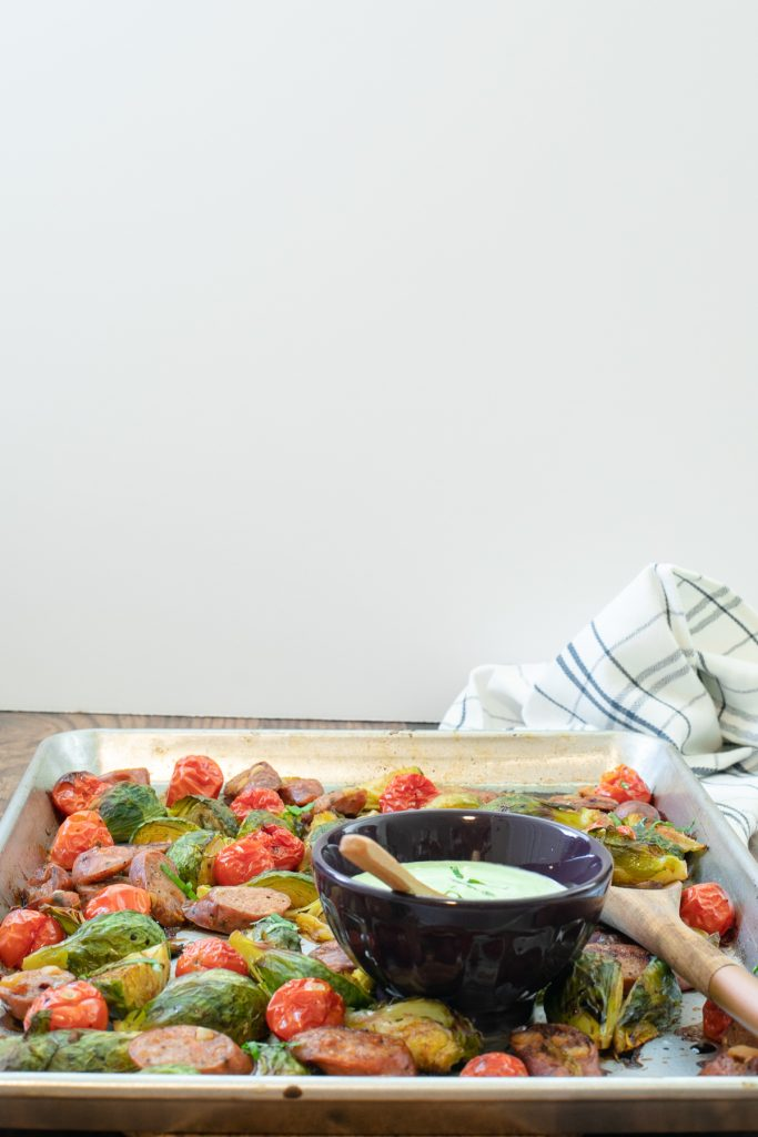 Easy Low Carb Lunch or Dinner Idea - Roasted brussels sprouts, tomatoes, and sausage. Keto sheet pan dinner
