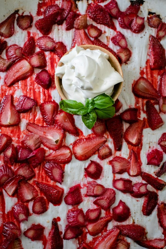 Basil vanilla whipped cream, served with roasted strawberry rhubarb topping.