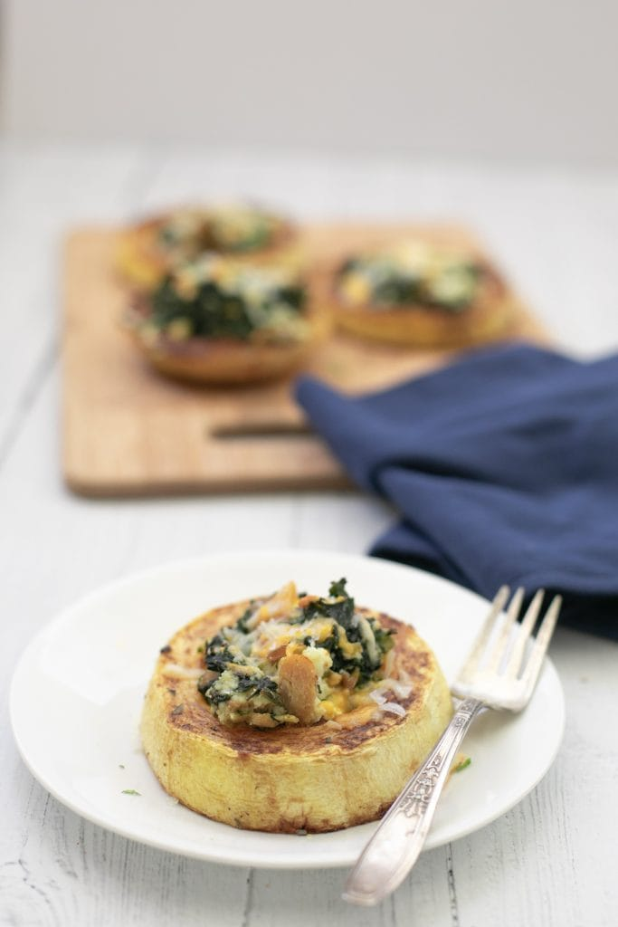 Spaghetti Squash roasted then stuffed with chicken, ricotta, and spinach. A wonderful low carb dish! #keto #spaghettisquash #lowcarb