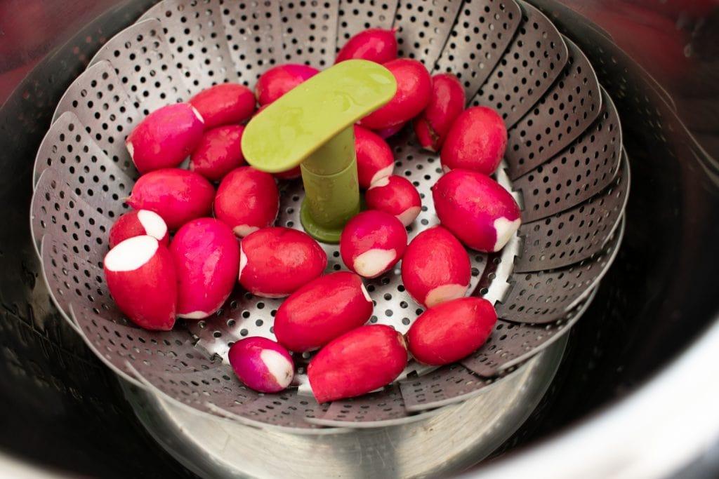 Radishes in a steamer basket