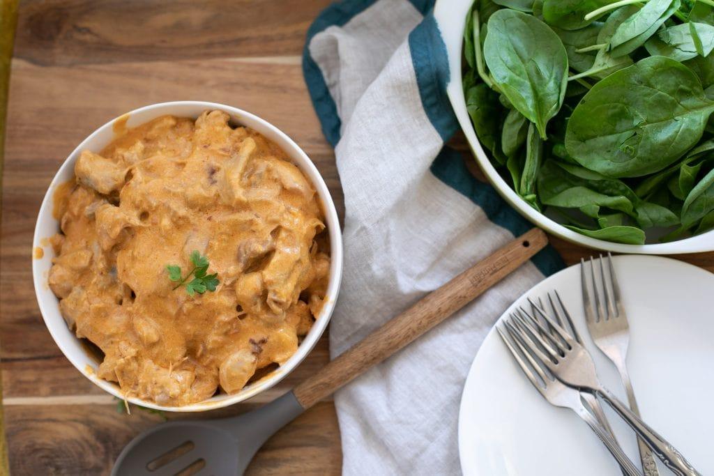 Paprika chicken with a creamy, cheesy garlic sauce