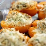 Baked bell pepper stuffed with chicken, mushrooms, and cheese