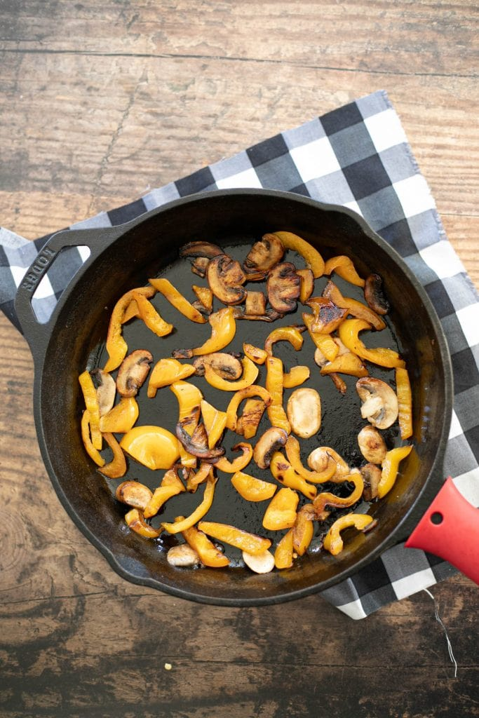 Saute bell peppers and mushrooms as the base of the frittata