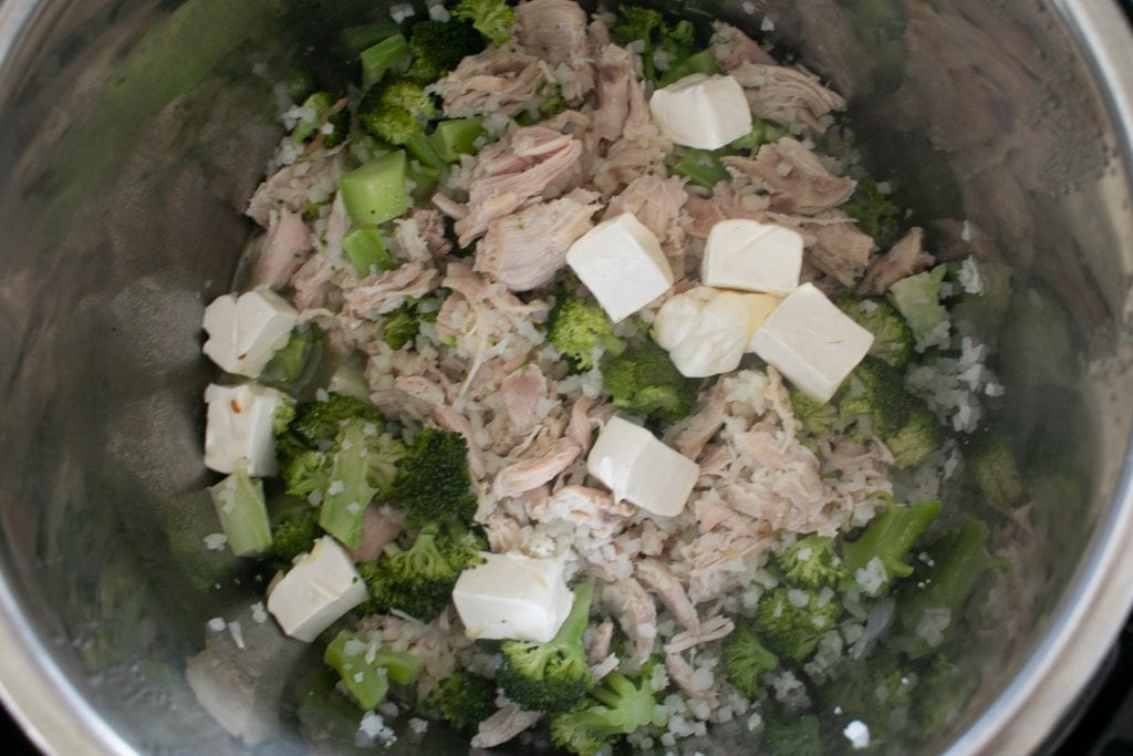 Process of cooking in the Instant Pot: Add cream cheese after the vegetables and chicken have cooked.