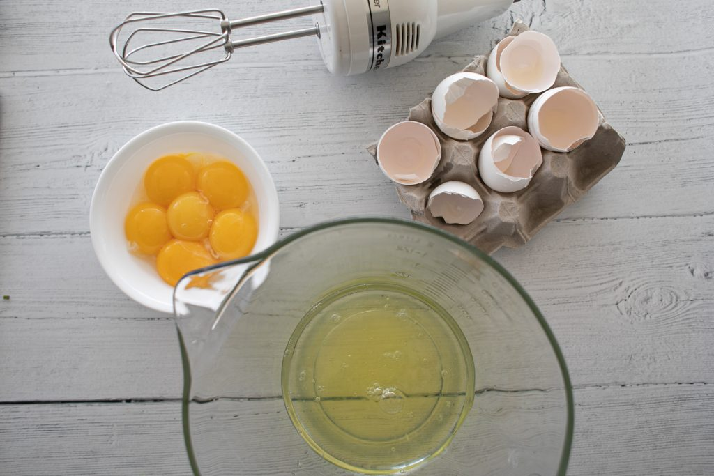 Separate the egg whites and yolks, place the whites in a large mixing bowl