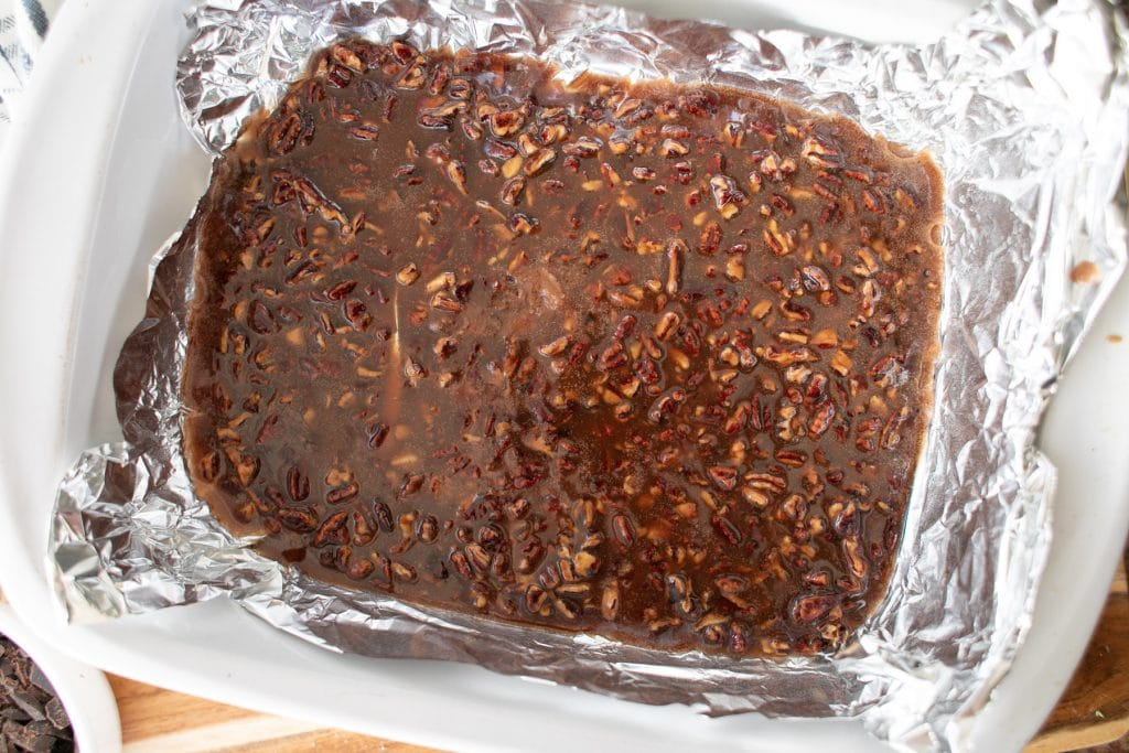 Pour the keto toffee into a prepared dish to allow it to harden